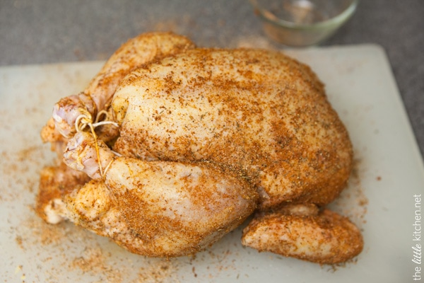whole chicken tied with kitchen twine on a cutting board