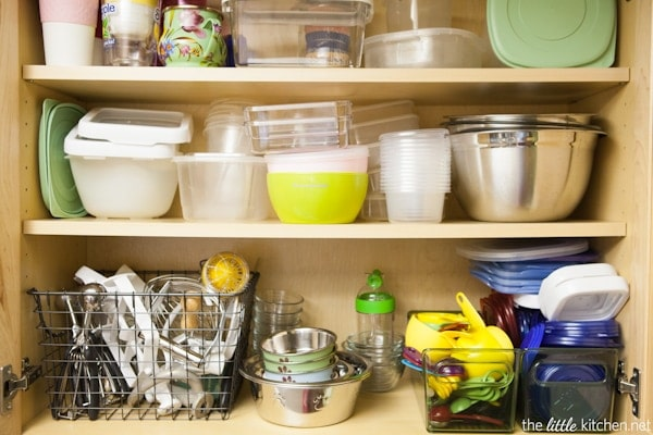 Kitchen Organizing Tip: In your cabinets, use baskets and bins to organize food storage containers & lids as well measuring cups and spoons.
