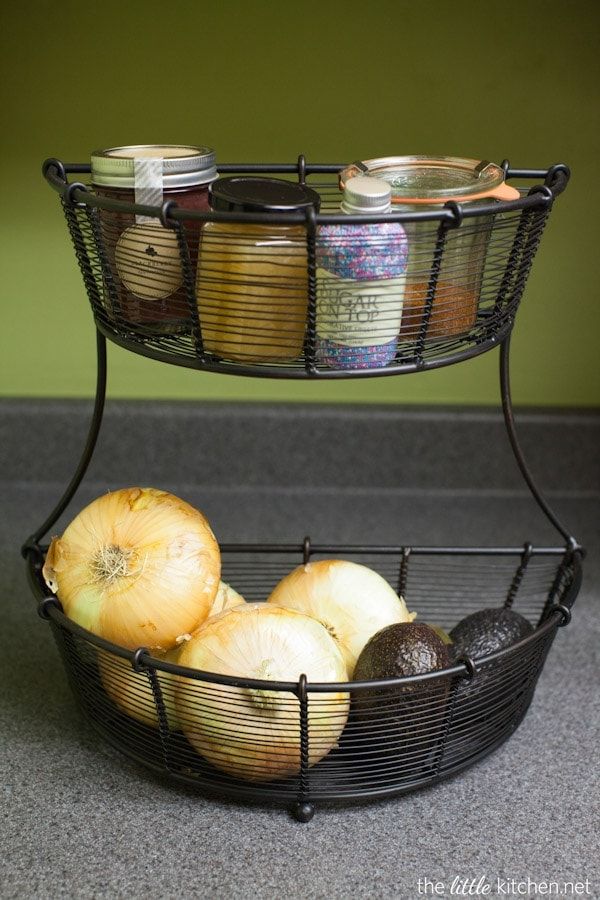 Kitchen Organizing Tip: Remove clutter (put away things you don't use every day) and utilize vertical space on your counters.