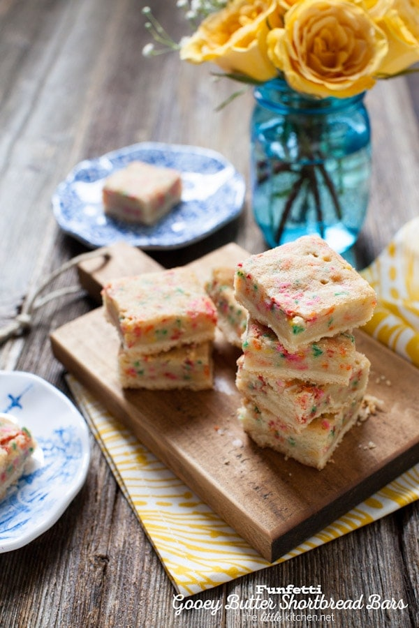 These bars are so gooey and perfect...the sprinkles are a must! Funfetti Gooey Butter Shortbread Bars from thelittlekitchen.net