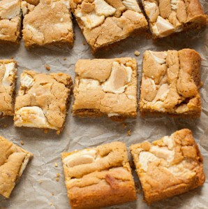 These bars are so easy to make...the crust is made with graham cracker crumbs & I used white chocolate Reese's butter cups! Peanut Butter Cookie Pie Bars from thelittlekitchen.net