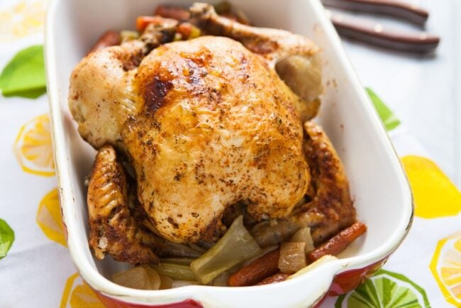 whole chicken in a baking dish
