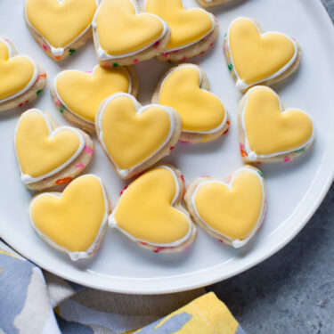 Yellow Heart-Shaped Rainbow Funfetti Cookies from thelittlekitchen.net