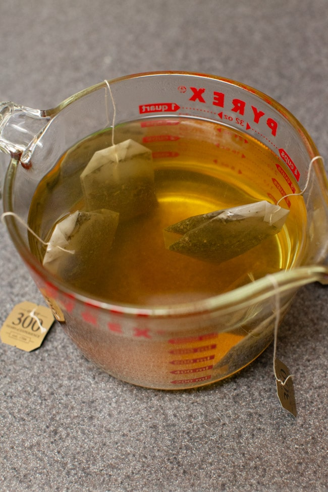 tea bags steeping in a measuring cup