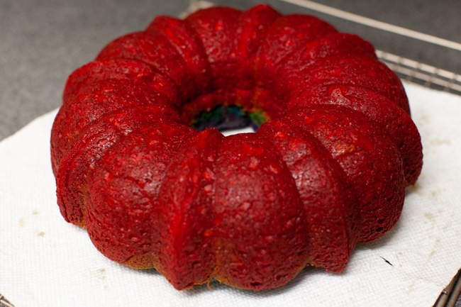 Baked rainbow Bundt cake out of pan