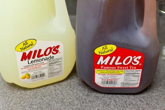 a jug of lemonade and a jug of sweet tea