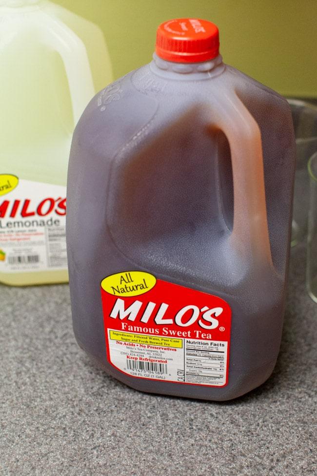 a jug of sweet tea and a jug of lemonade on the counter