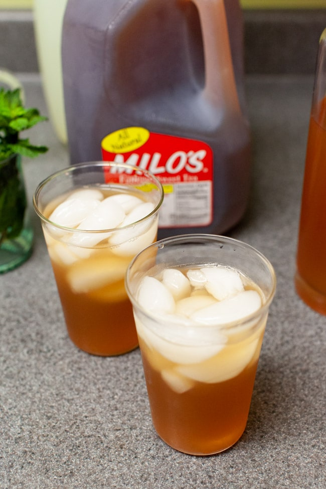 two glasses of iced tea with vodka and lemonade on a kitchen counter