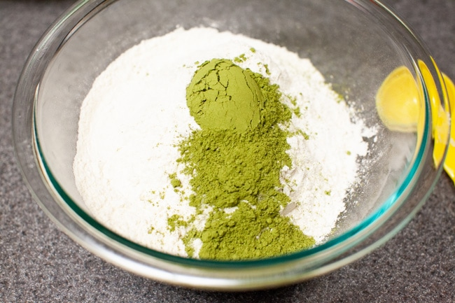 Matcha powder added to flour and salt in glass bowl for Matcha Cookies from thelittlekitchen.net