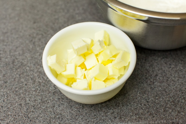 Cubed pieces of butter in small white bowl