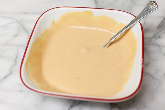 dipping sauce for cheeseburger egg rolls in a white bowl
