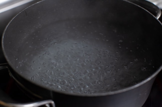 a pot of boiling water with baking soda