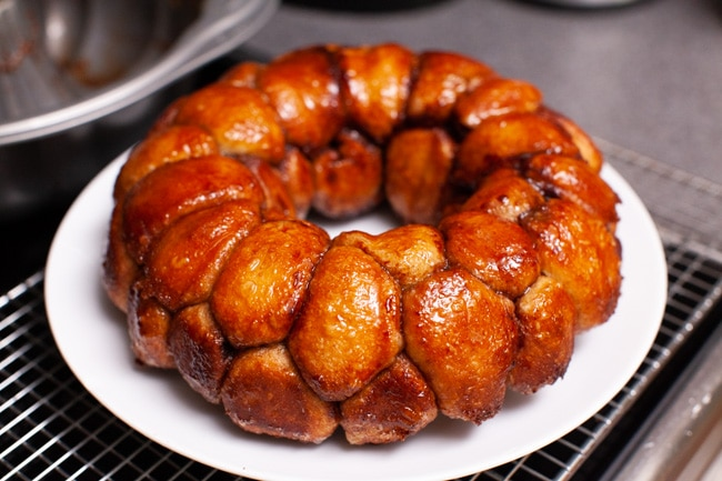 monkey bread on a plate with a napkin and a pitcher