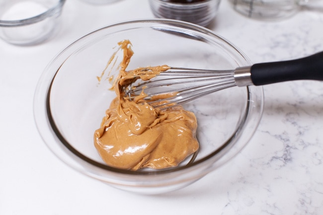 peanut butter in a bowl with a whisk